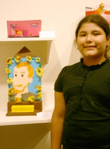 Alexandra Morazan of Seaton Elementary School with her piece on Van Gogh.
