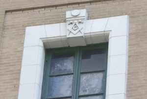 The Masonic Square and Compasses atop a window.