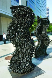 Chakaia Booker, Gridlock, 2008; Rubber tire and stainless steel, 2 pieces, 100 x 48 x 20 in. each; Image Franck Espich, Courtesy Marlborough Gallery, New York