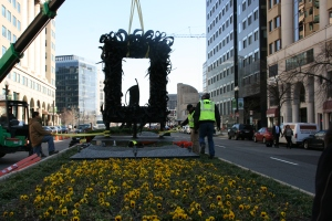Chakaia Booker, Take Out, 2008; work being installed on New York Avenue outside NMWA