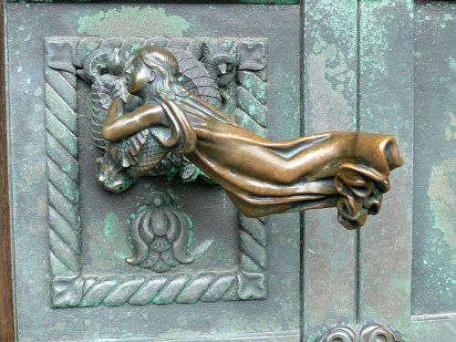 Anne Marie Carl-Nielsen, Door handle depicting an angel, 1904, Ribe Cathedral, Denmark